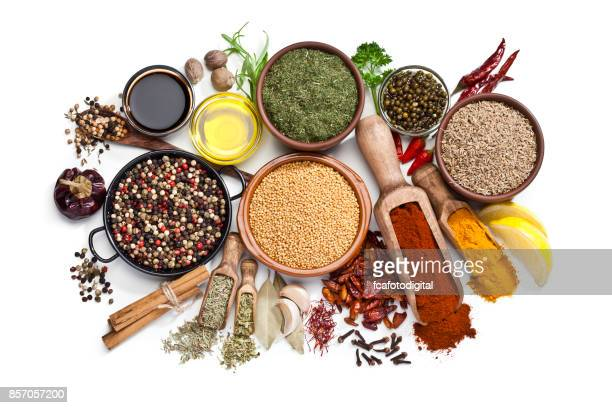 spices and herbs isolated on white background - spice stock pictures, royalty-free photos & images