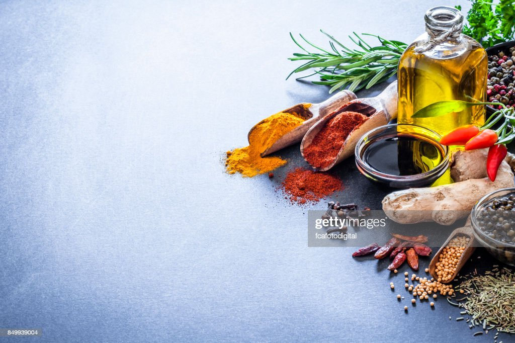 Spices and herbs on bluish kitchen table : Stock Photo