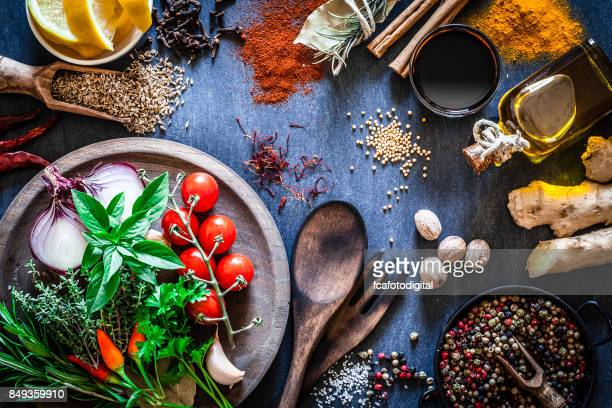Spices and herbs on dark kitchen table