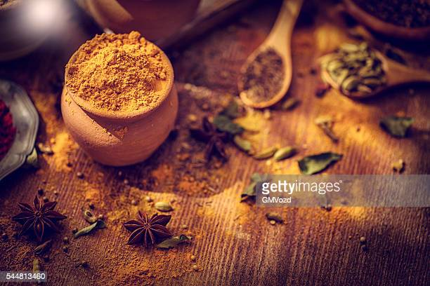 Spices and Herbs on Wooden Background