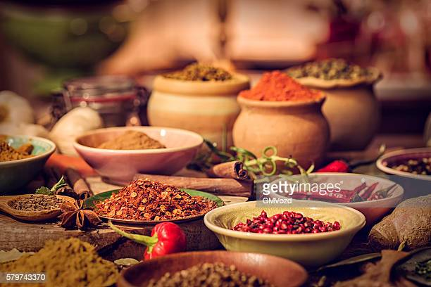 spices and herbs on wooden background - curry powder stock photos and pictures
