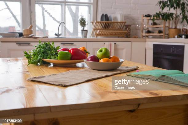 spices and old recipe book on wooden background on kitchen. - kitchen counter stock pictures, royalty-free photos & images
