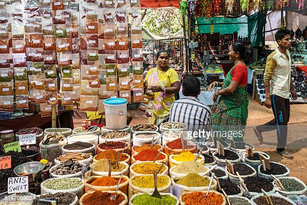 Spices and teas sit on display at a stall in the Anjuna beach flea market in Anjuna Goa India on Wednesday March 9 2016 While India is forecast to...
