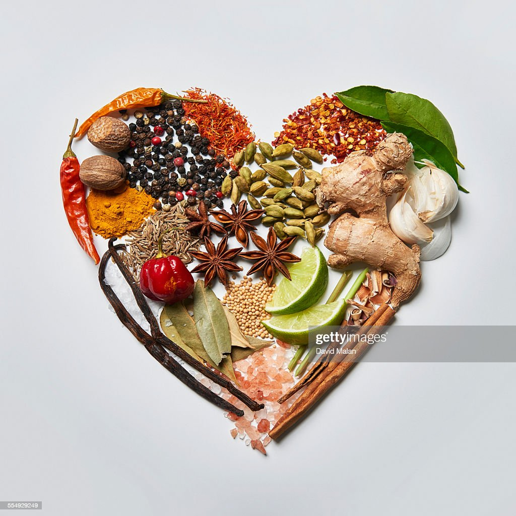 Spices arranged in a heart shape. : Stock Photo