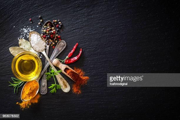 Spices background on black slate background