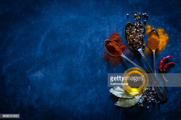Spices background on bluish tint kitchen table