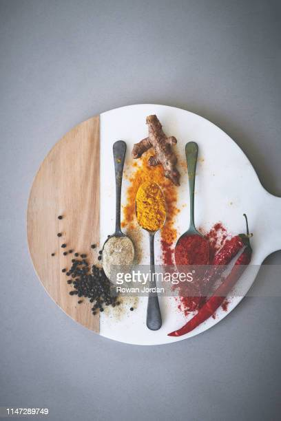 spices contribute rich flavor to food without adding any calories - essentials collection stock pictures, royalty-free photos & images