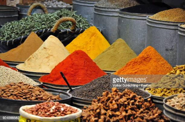 spices for sale at market stall - spices stock photos and pictures