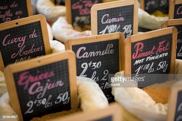 Spices - Handwritten Blackboard Signs At A Market In France