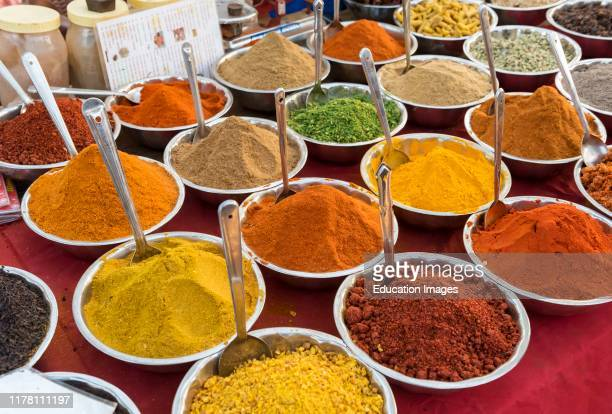 Spices herbs and curry powders on display at Anjuna Beach Flea Market Goa India