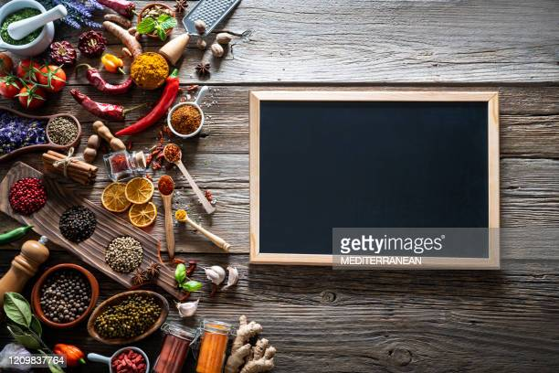 spices herbs condiments seasoning on rustic wooden table - blackboard stock pictures, royalty-free photos & images
