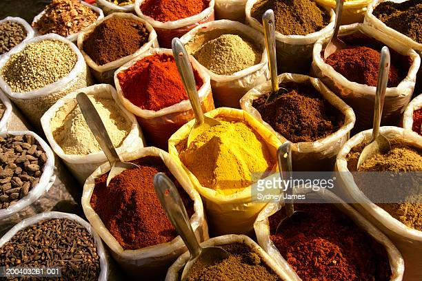 spices in containers at market - spices stock photos and pictures