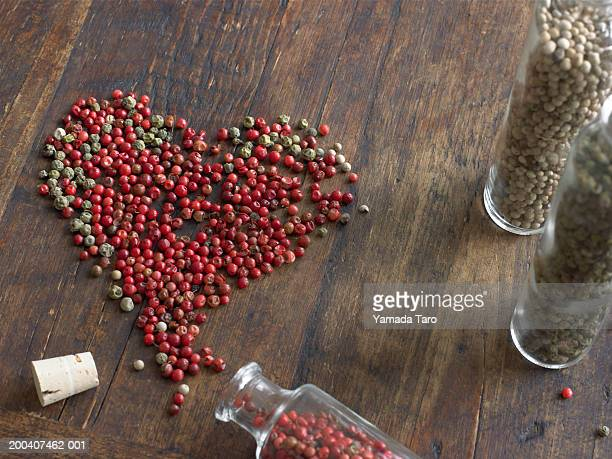 Spices in heart shape with bottles