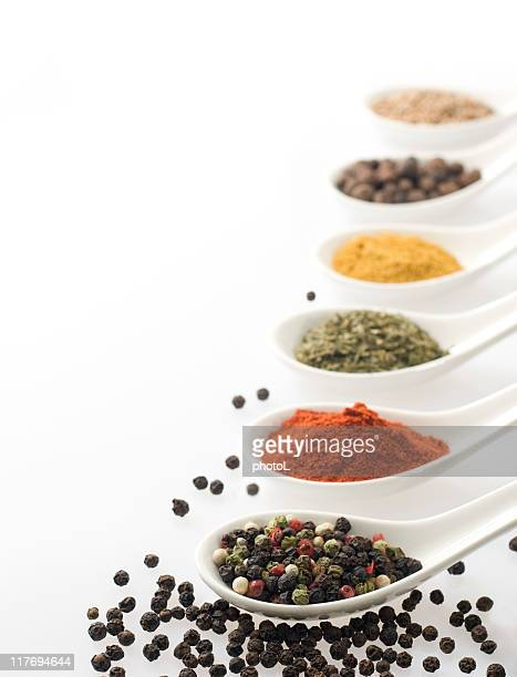 Spices in white spoons.