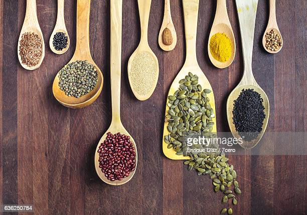 spices, nuts, seeds, grains and pulses. - nut food stock pictures, royalty-free photos & images
