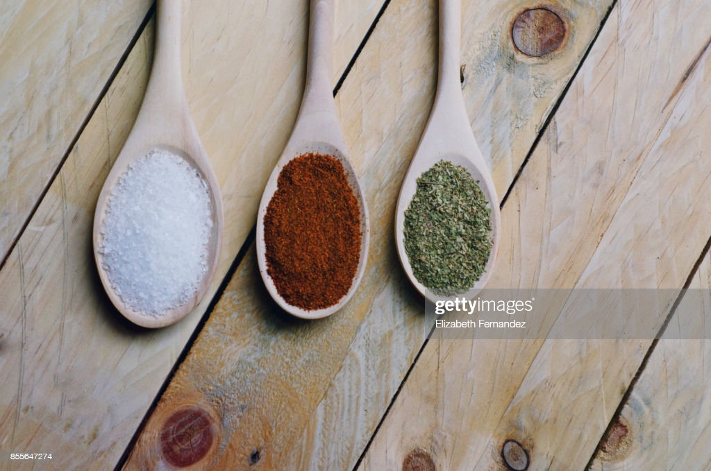 Spices on spoons in wooden background : Stock Photo
