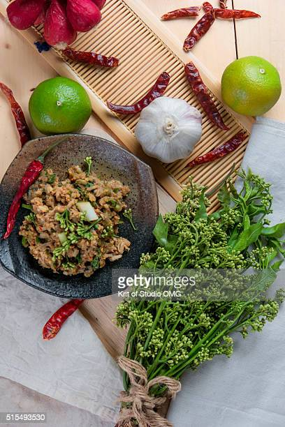 Spicy catfish with neem flower