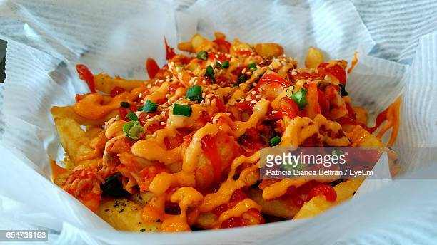 Spicy French Fries Garnish With Herbs