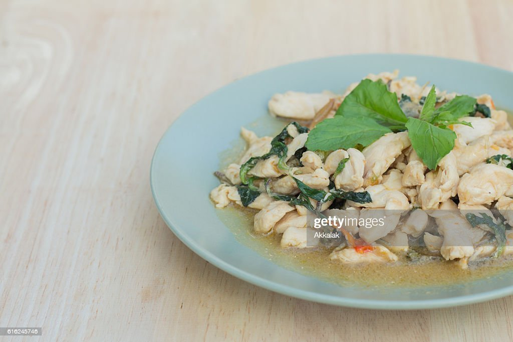 Spicy fried chicken with basil leaves : Stock Photo