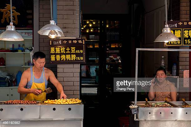 Spicy fried food stalls on the street According to communique published by the Fifth Plenary Session of the 18th CCP Congress a national food safety...