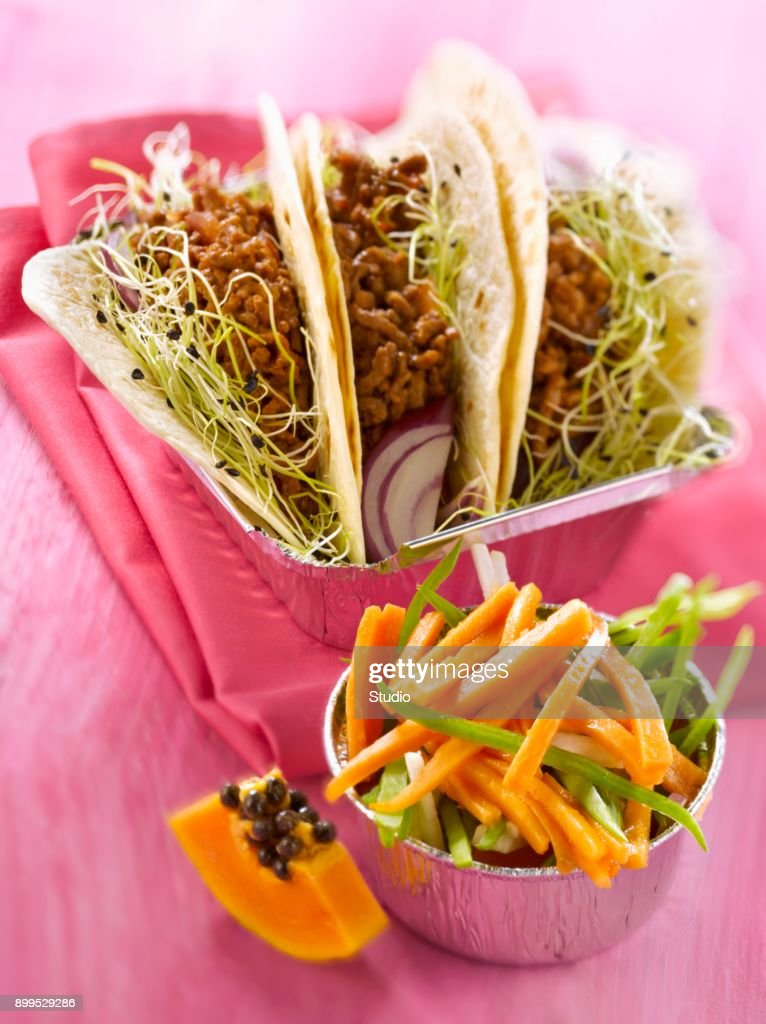 Spicy minced meat tacos,papaya salad : Stock Photo