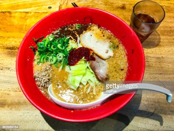 Spicy Miso Ramen Served in Red Bowl on Table