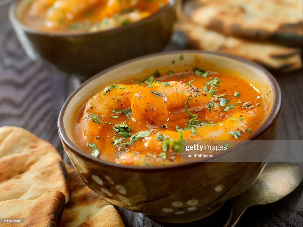 Spicy Red Curry Soup with Shrimp and Naan Bread : Stock Photo