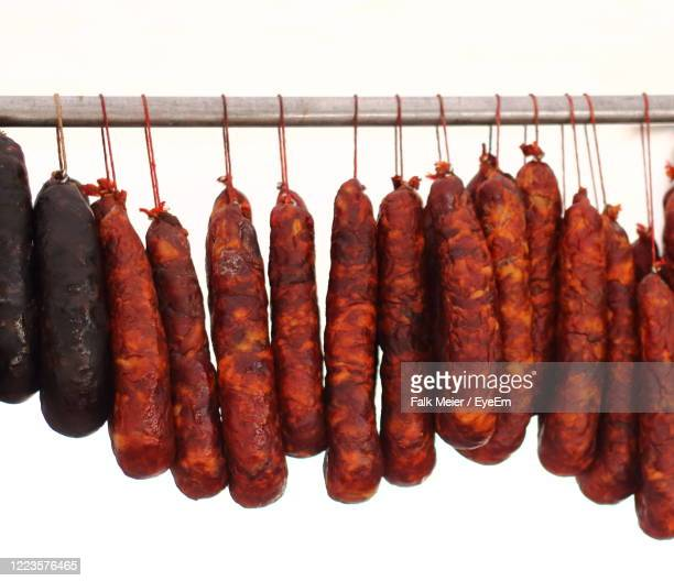 spicy sausages lines up in tasty fashion - chorizo stock pictures, royalty-free photos & images