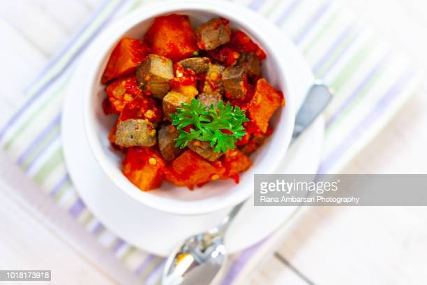 Spicy Stir-Fried potato and liver - Indonesian Food - shot overhead in clean simple styling