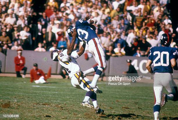 Spider Lockhart of the New York Giants guards Gene Washington of the Minnesota Vikings during an NFL football game at Yankee Stadium September 21...