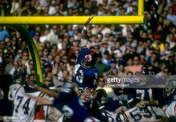 Spider Lockhart of the New York Giants leaps in an attempt to block a field goal try by the Minnesota Vikings during an NFL football game at Yankee...