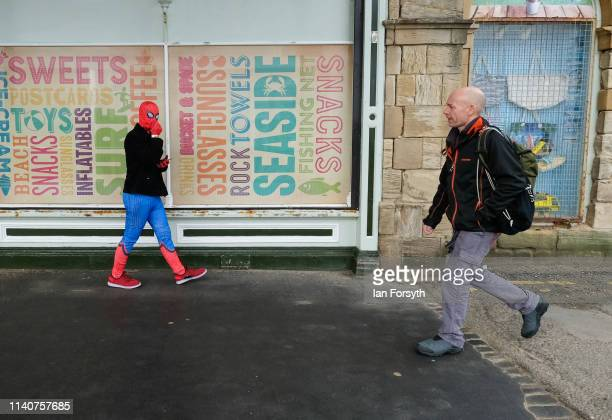 Spider man character walks along the seafront on the first day of the Scarborough Sci-Fi weekend at the seafront Spa Complex on April 06, 2019 in...