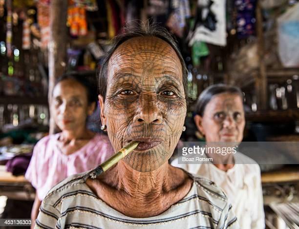 CONTENT] 'Spider web' tattooed Chin women in their village in western Myanmar