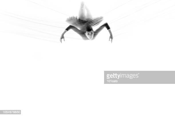 Spider woman dancing behind thin nylon