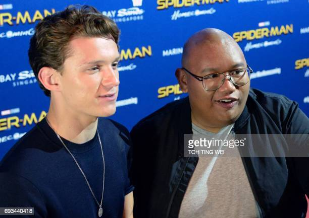 SpiderMan actors Tom Holland and Jacob Batalon speak to media during a promotional event for the forthcoming SpiderMan Homecoming movie at the...