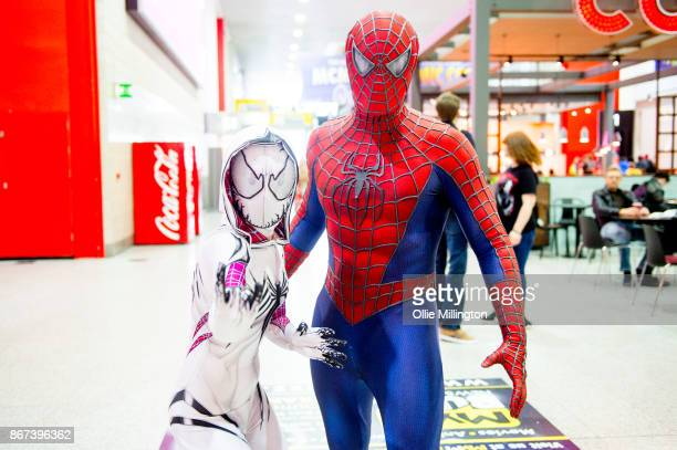 Spiderman and a SpiderQwen cosplayer during MCM London Comic Con 2017 held at the ExCel on October 28 2017 in London England
