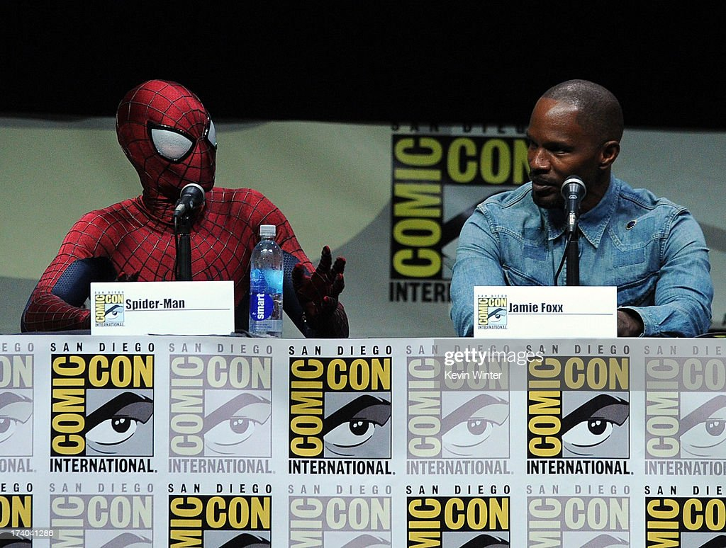 Spider-Man (L) and actor Jamie Foxx speak onstage at the Sony and Screen Gems panel for 'The Amazing Spider-Man 2' during Comic-Con International 2013 at San Diego Convention Center on July 19, 2013 in San Diego, California.
