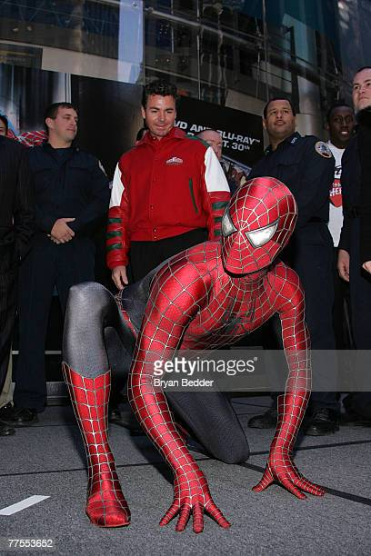 SpiderMan impersonator appears onstage during the SpiderMan and Papa John's Pizza's announcement of Hometown SuperHeroes in Times Square October 29...