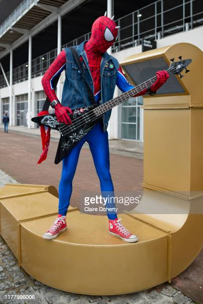 Spiderman plays the guitar on the first day of MCM Comic Con 2019 at Excel centre on 25th October 2019 in London England United Kingdom