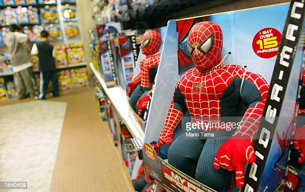 'SpiderMan' toys sit on the shelves at a ToysRUs store May 7 2002 in New York City 'SpiderMan' the movie shattered records becoming the first movie...