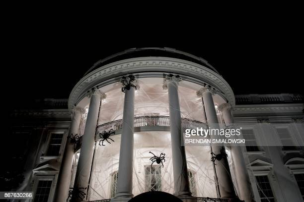 TOPSHOT Spiders are seen decorating the White House for Halloween October 28 2017 in Washington DC / AFP PHOTO / Brendan Smialowski