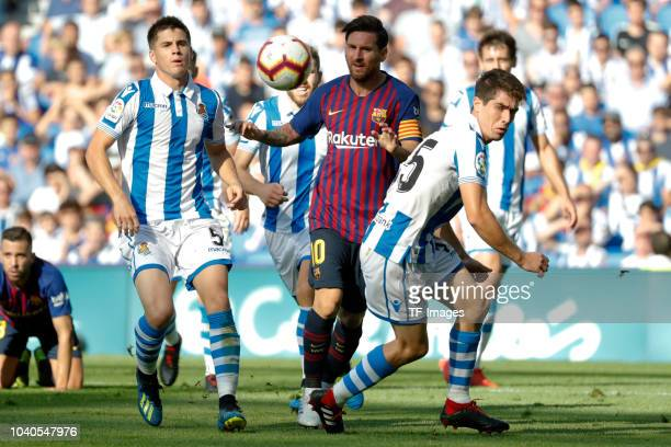 Spieler of Real Sociedad and Lionel Messi of Barcelona battle for the ball during the La Liga match between Real Sociedad and FC Barcelona at Estadio...