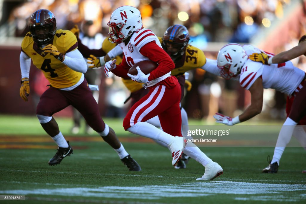 JD Spielman #10 of the Nebraska Cornhuskers carries the ball for a gain against the Minnesota Golden Gophers at TCF Bank Stadium on November 11, 2017 in Minneapolis, Minnesota.