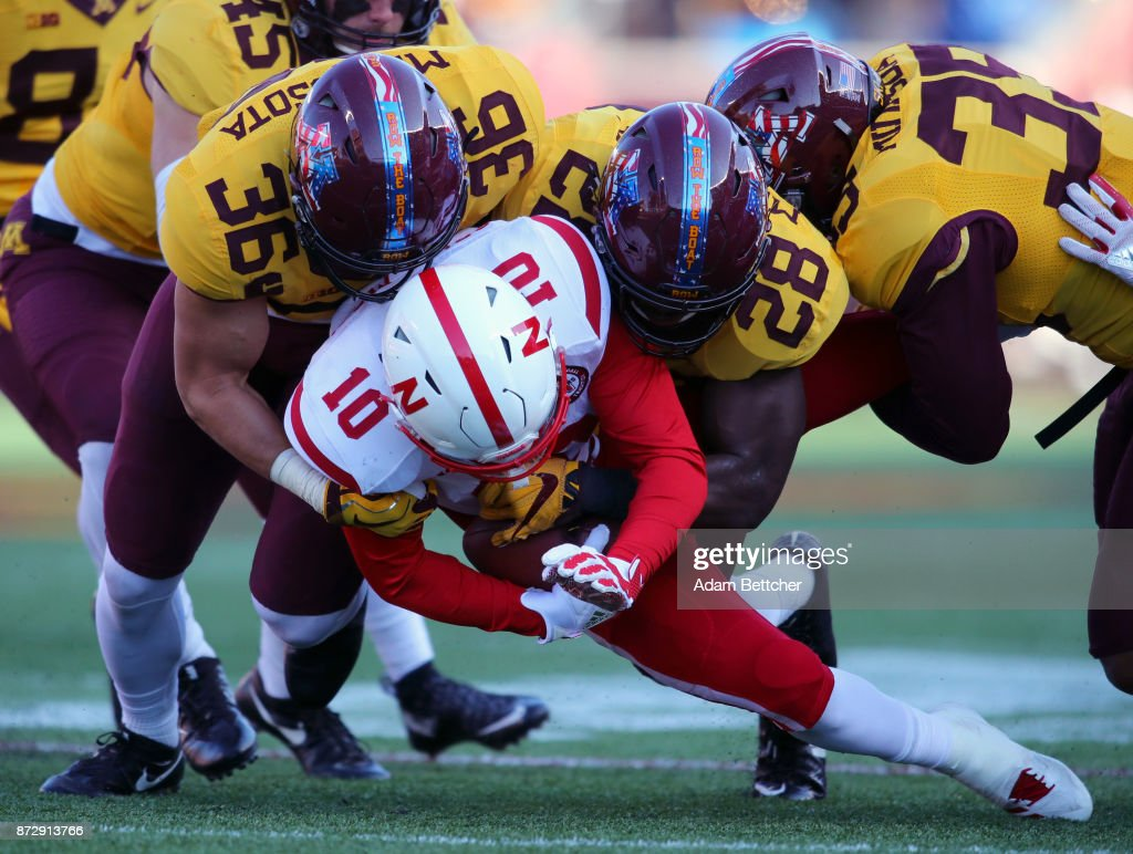 JD Spielman #10 of the Nebraska Cornhuskers gets tackled by Blake Cashman #36 and Jonathan Femi-Cole #28 of the Minnesota Golden Gophers in the second quarter at TCF Bank Stadium on November 11, 2017 in Minneapolis, Minnesota.