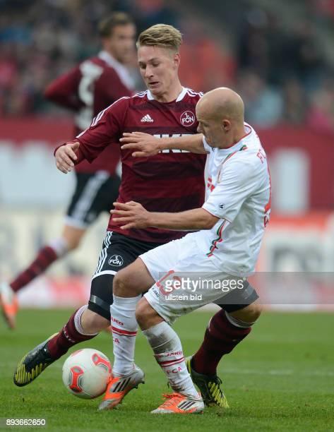 8 Spieltag Saison 2012/2013 FUSSBALL 1 BUNDESLIGA SAISON 2012/2013 8 Spieltag Nuernberg FC Augsburg Tobias Werner gegen Sebastian Polter