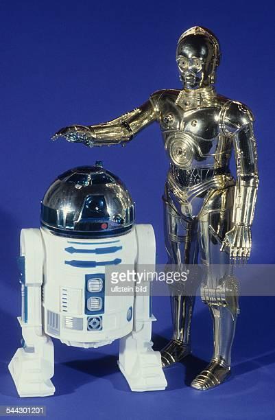 Spielzeugroboter Roboter R2D2 und C3 PO aus dem Spielfilm 'Krieg der Sterne 1977