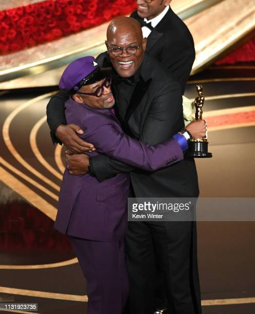 Spike Lee accepts the Adapted Screenplay award for 'BlacKkKlansman' from Samuel L Jackson onstage during the 91st Annual Academy Awards at Dolby...