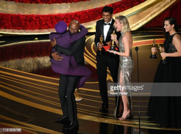 Spike Lee accepts the Best Adapted Screenplay award for BlacKkKlansman from Samuel L Jackson onstage during the 91st Annual Academy Awards at Dolby...