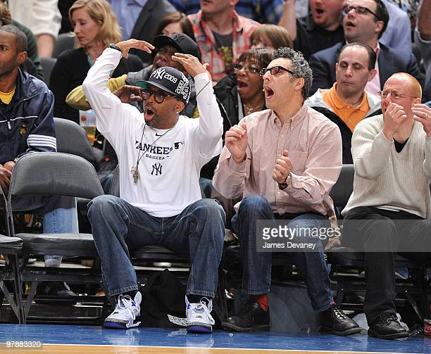 Spike Lee and John Turturro attend a game between the Philadelphia 76ers and the New York Knicks at Madison Square Garden on March 19 2010 in New...