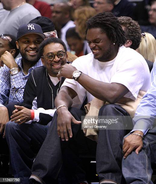 Spike Lee and LaVar Arrington during Celebrities Attend New Jersey Nets vs Indiana Pacers Game April 25 2006 at Continental Arena in East Rutherford...